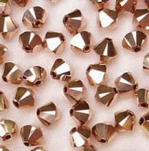 4mm Swarovski 5328 Xilion Rose Gold x2 - 50