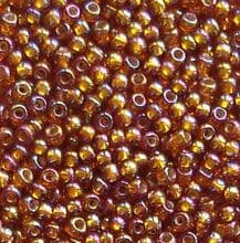 Toho 11/0 Seed Beads, Silver Lined Rainbow Topaz 2034 - 10 grams
